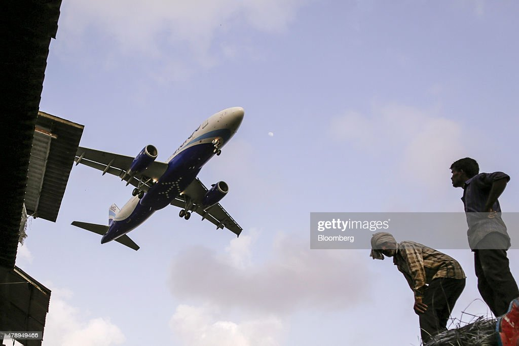 An Airbus SAS A320 aircraft operated by IndiGo approaches to land at Chhatrapati Shivaji International Airport in Mumbai, India, on Saturday, June 27, 2015. IndiGo, owned by Interglobe Enterprises Ltd., is India's biggest airline by market share according to the Indian Aviation Ministry. Photographer: Dhiraj Singh/Bloomberg via Getty Images