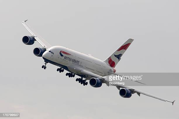 An Airbus SAS A380 aircraft operated by British Airways performs in a flying display on the second day of the Paris Air Show in Paris France on...