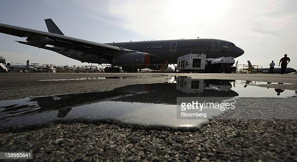 An Airbus SAS Military AirTanker aircraft is reflected in a pool of water at the Singapore Airshow in Singapore on Wednesday Feb 15 2012 The airshow...