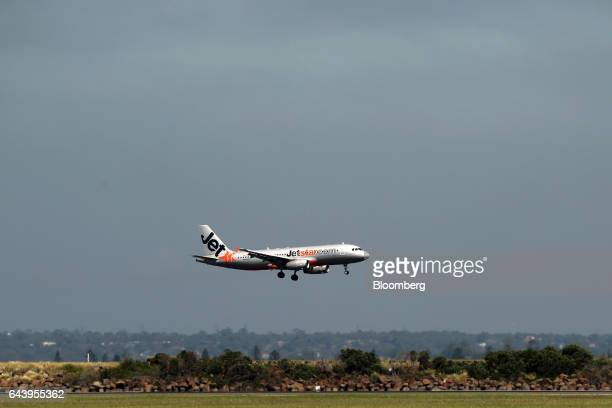 An Airbus SE A320200 aircraft operated by Jetstar Airways the budget arm of Qantas Airways Ltd lands at Sydney Airport in Sydney Australia on...
