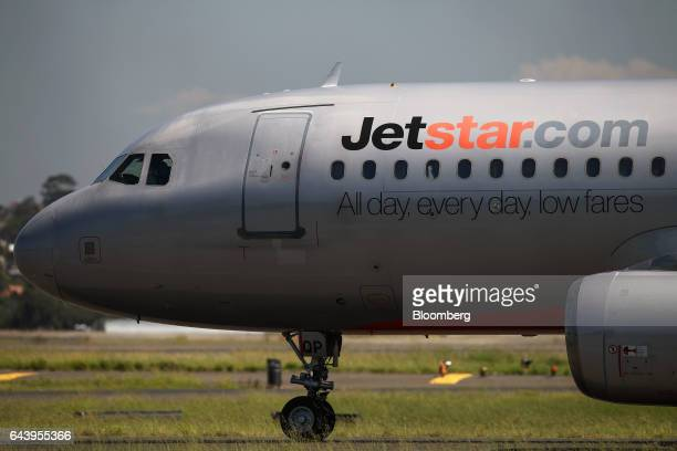 An Airbus SE A320200 aircraft operated by Jetstar Airways the budget arm of Qantas Airways Ltd taxis along the tarmac at Sydney Airport in Sydney...