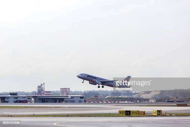 An Airbus SE A320200 aircraft operated by Jetstar Airways the lowcost unit of Qantas Airways Ltd takes off from Changi Airport in Singapore on...