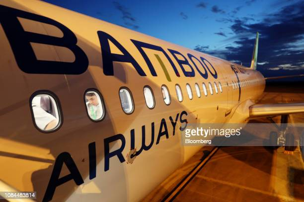 An Airbus SE A321 Neo aircraft operated by FLC Group JSC's Bamboo Airways stands on the tarmac on the first day of the airline's operations at Phu...