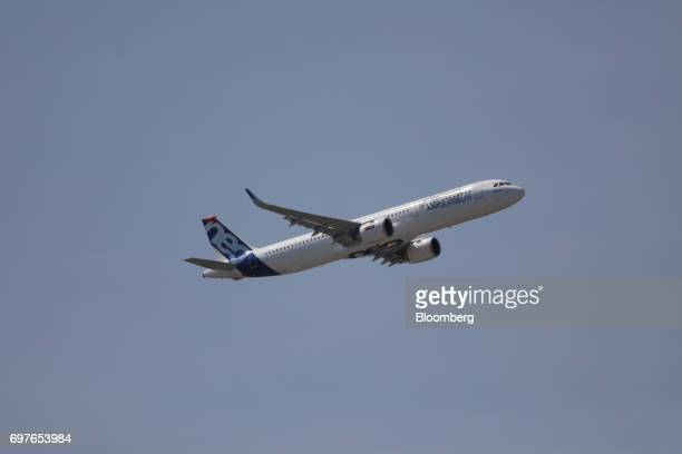 An Airbus SE A321 Neo passenger aircraft performs a flying display at the 53rd International Paris Air Show at Le Bourget in Paris France on Monday...