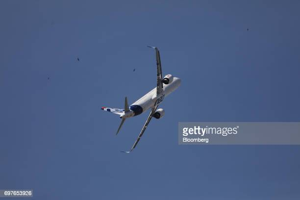 An Airbus SE A321 Neo passenger aircraft performs maneuvers during an aerobatic flying display at the 53rd International Paris Air Show at Le Bourget...
