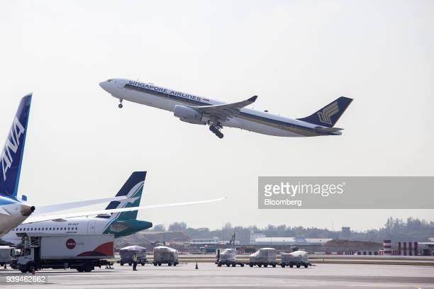 An Airbus SE A330343 aircraft operated by Singapore Airlines Ltd takes off at Changi Airport in Singapore on Wednesday March 28 2018 Singapore's...