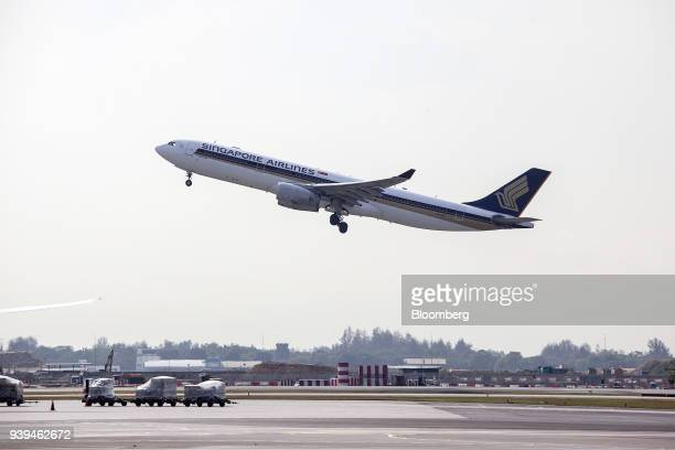 An Airbus SE A330343 aircraft operated by Singapore Airlines Ltd takes off from Changi Airport in Singapore on Wednesday March 28 2018 Singapore's...
