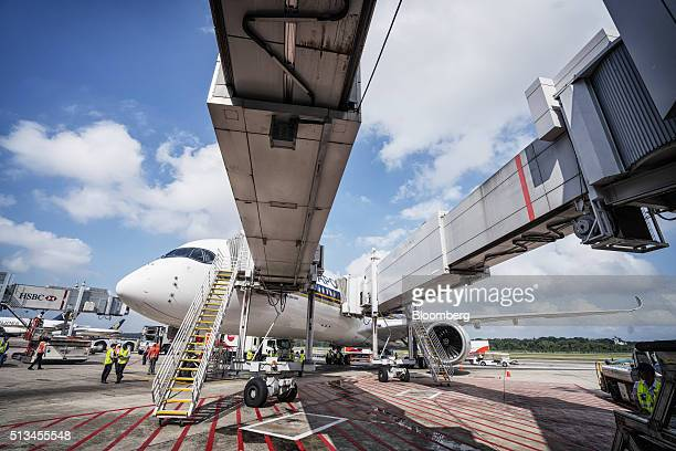 An Airbus SE A350 aircraft operated by Singapore Airlines Ltd sits during an arrival ceremony at Changi Airport in Singapore on Thursday March 3 2016...
