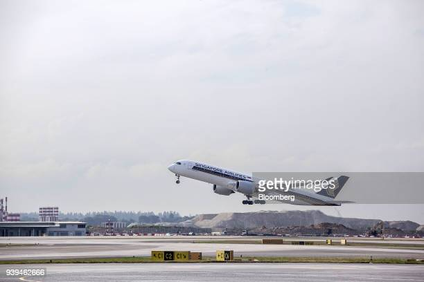 An Airbus SE A350941 aircraft operated by Singapore Airlines Ltd takes off from Changi Airport in Singapore on Wednesday March 28 2018 Singapore's...