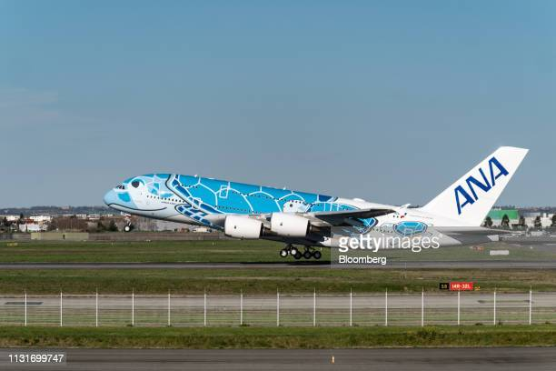 An Airbus SE A380 aircraft with ANA Holdings Inc's unique livery depicting sea turtles native to Hawaii takes off from the Airbus factory in Toulouse...