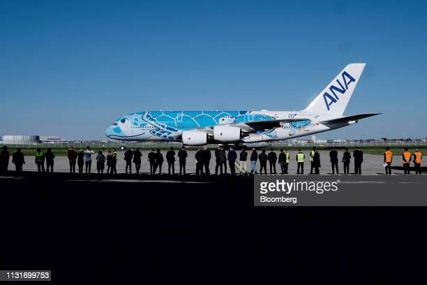 An Airbus SE A380 aircraft with ANA Holdings Inc's unique livery depicting sea turtles native to Hawaii prepares to take off from the Airbus factory...