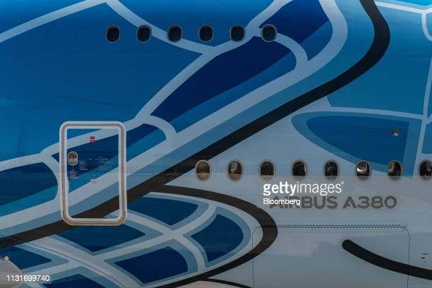 An Airbus SE A380 logo sits on fuselage decorated with ANA Holdings Inc's unique livery depicting sea turtles native to Hawaii outside the Airbus...