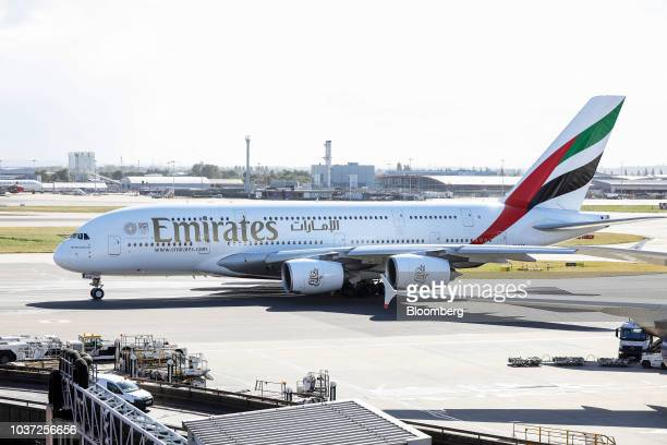 An Airbus SE A380 passenger aircraft operated by Emirates Airline taxis on the tarmac at London Heathrow Airport in London UK on Friday Sept 21 2018...