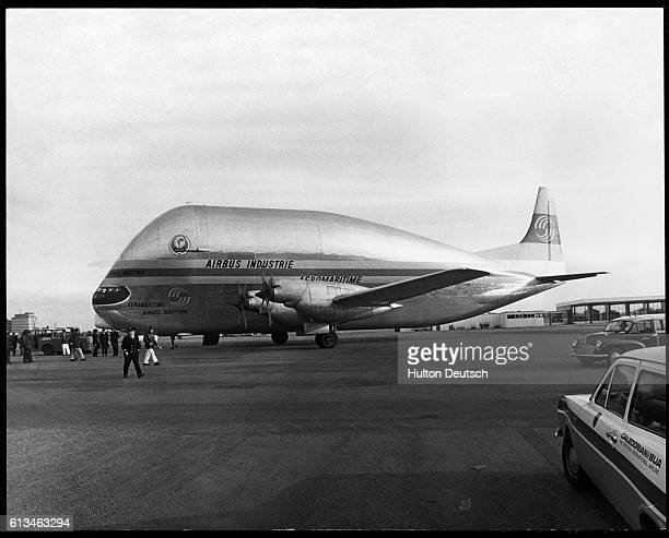 An Airbus Super Guppy is towed into a hangar at Ringway Airport. It will be transporting the first set of wings for the A300B airliner to Toulouse,...