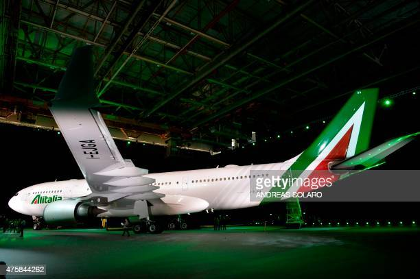 An aircraft airbus A330200 fom Italy's airline giant Alitalia is pictured during a press conference to present the new brand design and the new...