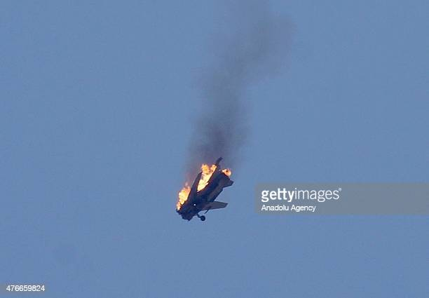 An aircraft belonging to Syrian regime forces bursts into flames after it was hit by Syrian oppositions linked to Southern Front when it was...