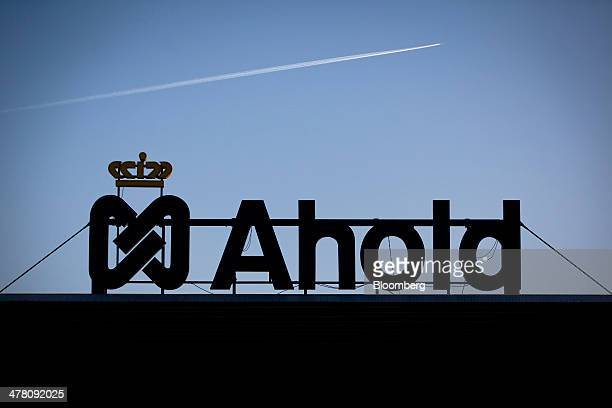 An aircraft contrail moves above a supermarket distribution center operated by Royal Ahold NV in Prague Czech Republic on Tuesday March 11 2014 Royal...