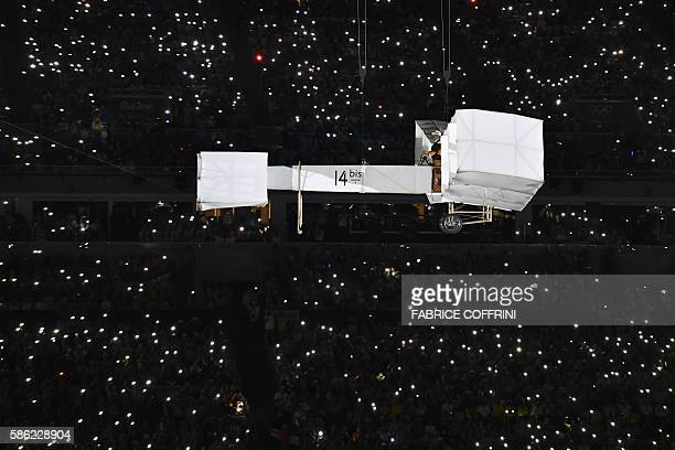 An aircraft forms part of the opening ceremony of the Rio 2016 Olympic Games at the Maracana stadium in Rio de Janeiro on August 5 2016 / AFP /...