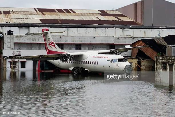 TOPSHOT An aircraft is parked at the flooded Netaji Subhas Chandra Bose International Airport after the landfall of cyclone Amphan in Kolkata on May...