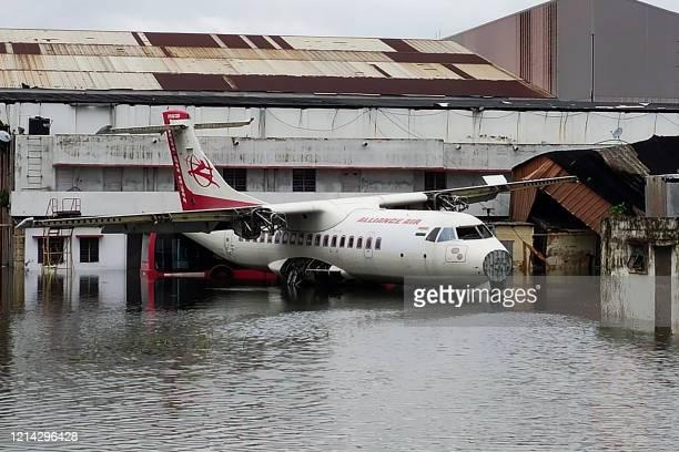 An aircraft is parked at the flooded Netaji Subhas Chandra Bose International Airport after the landfall of cyclone Amphan in Kolkata on May 21,...