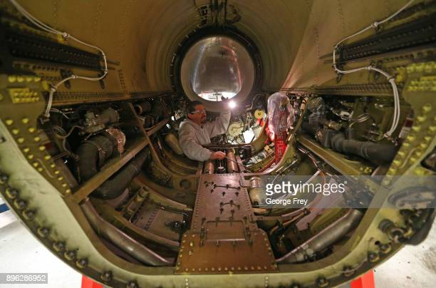 An aircraft mechanic checks out the engine compartment of an F16 Falcon on December 20 2017 at Hill Air Force base in Ogden Utah Hill Air Force Base...