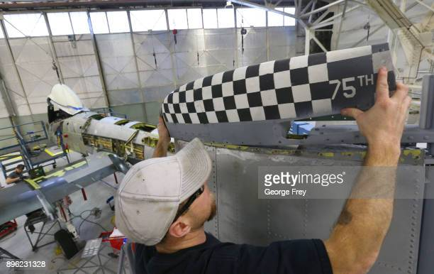 An aircraft mechanic installs a piece of the tail of an A10 Thunderbolt Warthog on December 20 2017 at Hill Air Force base in Ogden Utah Hill Air...