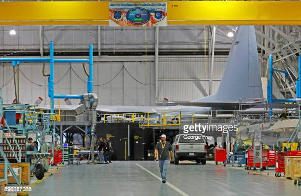 An aircraft mechanic walks the floor as they work on a C130 cargo plane on December 20 2017 at Hill Air Force base in Ogden Utah Hill Air Force Base...