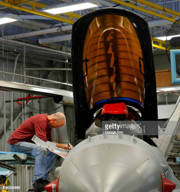 An aircraft mechanic works on an F16 Falcon on December 20 2017 at Hill Air Force base in Ogden Utah Hill Air Force Base has one of the largest...