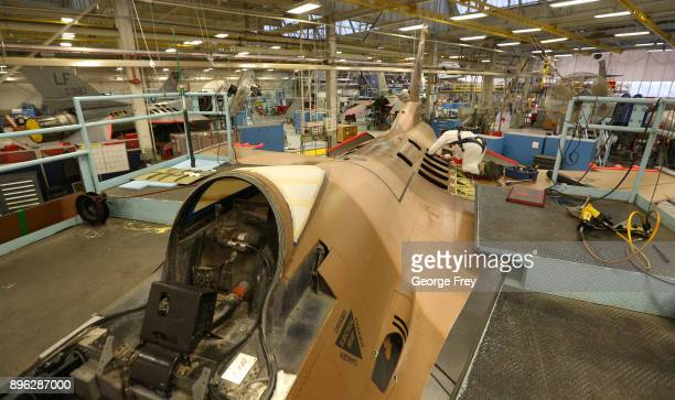An aircraft mechanic works on the body of an F16 Falcon on December 20 2017 at Hill Air Force base in Ogden Utah Hill Air Force Base has one of the...