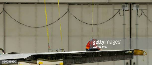 An aircraft mechanic works on the wing of a C130 cargo plane on December 20 2017 at Hill Air Force base in Ogden Utah Hill Air Force Base has one of...