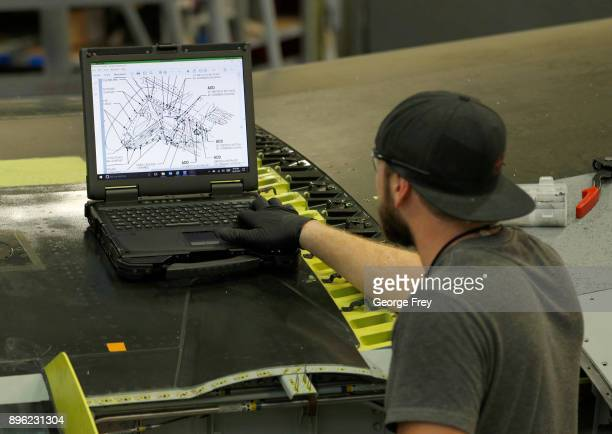 An aircraft mechanic works on the wing of an A10 Thunderbolt Warthog on December 20 2017 at Hill Air Force base in Ogden Utah Hill Air Force Base has...