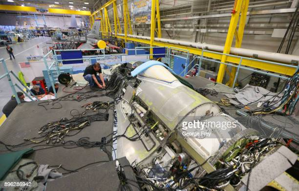 An aircraft mechanic works on the wiring on an F16 Falcon on December 20 2017 at Hill Air Force base in Ogden Utah Hill Air Force Base has one of the...