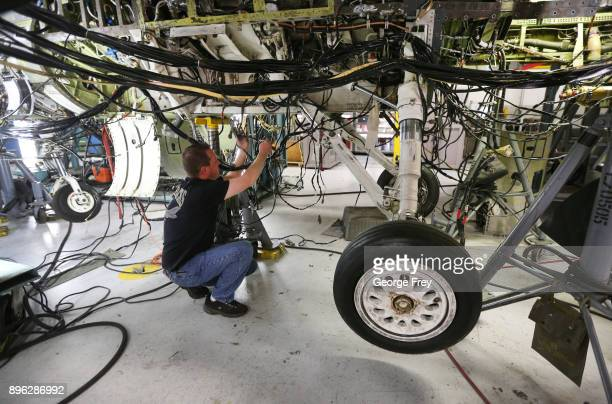 An aircraft mechanic works on then underside of an F16 Falcon on December 20 2017 at Hill Air Force base in Ogden Utah Hill Air Force Base has one of...