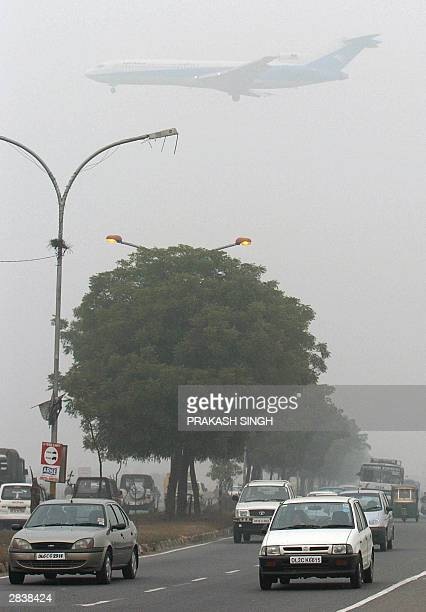 An aircraft of Afghanistan's Ariana airline comes into land over traffic on a foggy day at Indira Gandhi International Airport New Delhi 31 December...