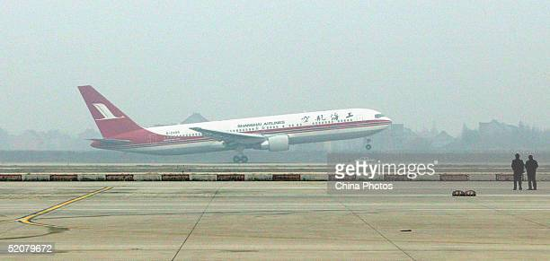 An aircraft of Shanghai Airlines takes off from the Pudong International Airport on January 29 2005 Shanghai China The landmark direct flights...