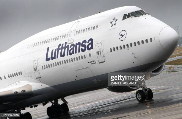 An aircraft of the German airline Lufthansa is pictured at the Frankfurt am Main airport in Frankfurt western Germany on June 12 2018
