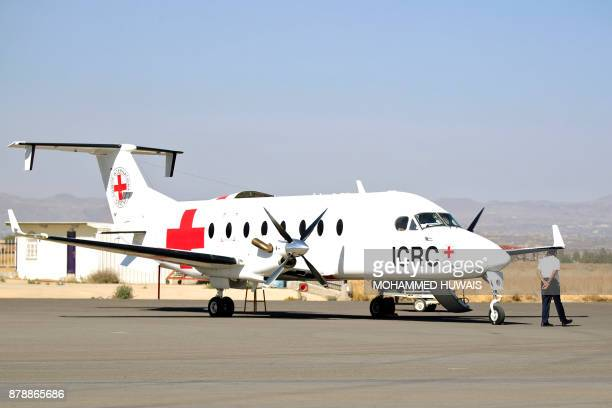 An aircraft of the International Committee of the Red Cross sits on the tarmac after landing in the rebelheld Yemeni capital Sanaa on November 25...