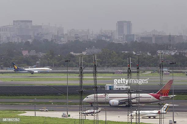 An aircraft operated by Air India Ltd is seen from a control tower as it taxis along the tarmac at Indira Gandhi International Airport in Delhi India...