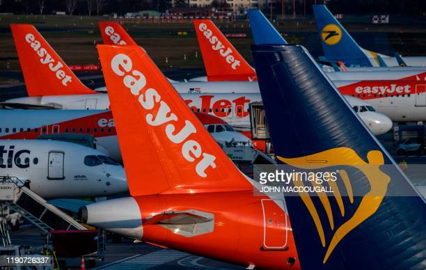 An aircraft operated by Irish lowcost airline Ryanair moves past aircraft operated by British low cost airline Easyjet at Tegel airport in Berlin on...