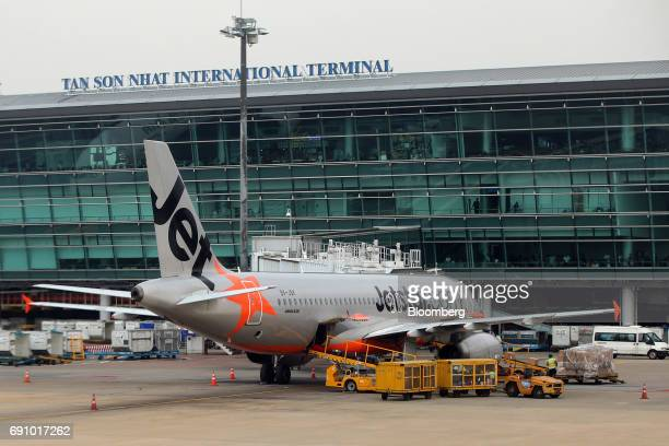 An aircraft operated by Jetstar Airways the budget arm of Qantas Airways Ltd sits on the tarmac at Tan Son Nhat International Airport in Ho Chi Minh...