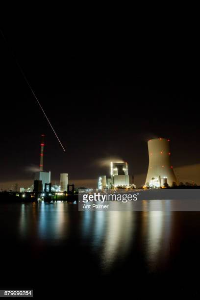 An aircraft passes above a STEAG Group coalfired powerstation located within Walsum Port November 23 2017 in Duisburg Germany The German energie...