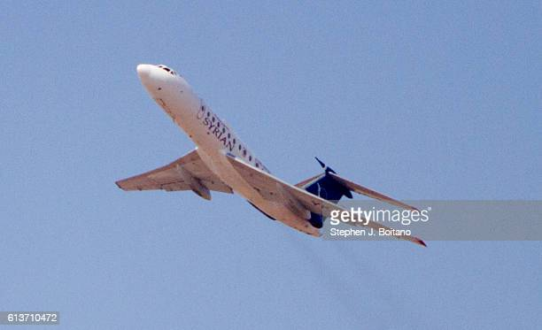 An aircraft takes off from Aleppo International Airport during the Eid Al Adah holiday. Free Syrian Army fighters fired rounds at it.