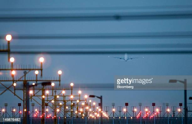 An aircraft takes off from Chek Lap Kok Airport in Hong Kong China on Sunday Aug 5 2012 The number of overseas visitors to Hong Kong rose 16 percent...