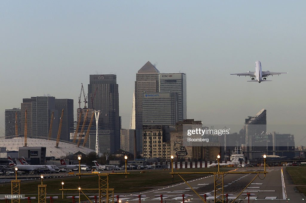 An aircraft takes off from City Airport against a backdrop of the Canary Wharf financial district in London, U.K., on Tuesday, Dec. 4, 2012. Air France-KLM Group's CityJet unit is studying options for a new investor, with a trade buyer a possibility given its strength at London City airport, Chief Executive Officer Christine Ourmieres said in an interview. Photographer: Chris Ratcliffe/Bloomberg via Getty Images