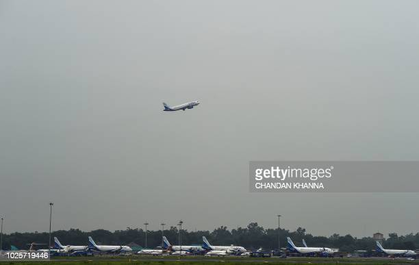 An aircraft takes off from Indira Gandhi International Airport in New Delhi on September 1 2018 Bargainbasement fares high oil prices and a tumbling...