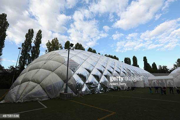 An airdome used as a temporary shelter for refugees on September 26 2015 in Berlin Germany Following the attacks in Paris that killed at least 129...