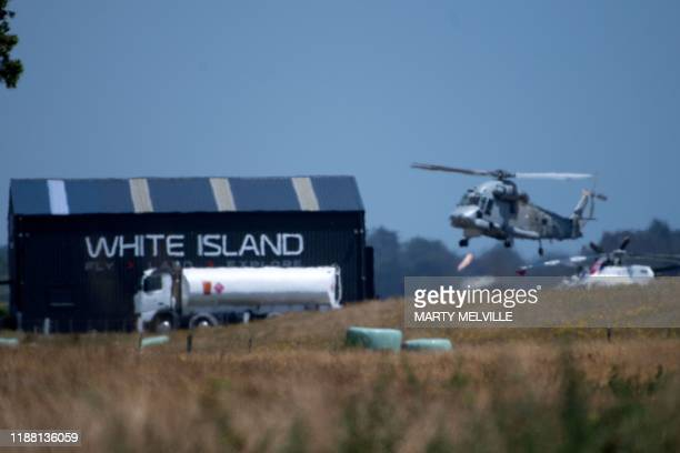 An airforce helicopter returns to Whakatane airport from White Island where a military team was dispatched to recover eight bodies after the December...