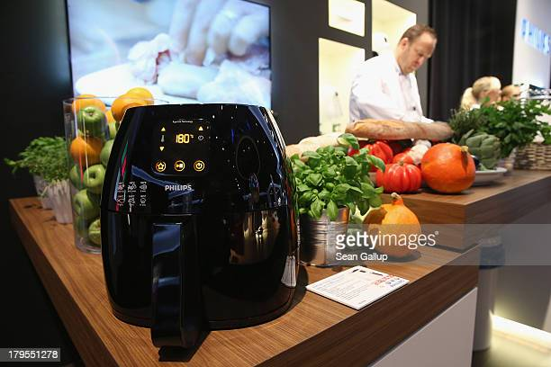 An Airfryer french fries maker stands on display at the Philips stand at the IFA 2013 consumer electronics trade fair on September 5 2013 in Berlin...