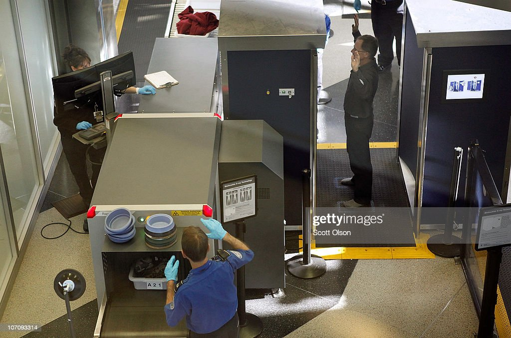 An airline passenger goes through a full-body scan at O'Hare Airport on November 23, 2010 in Chicago, Illinois. Opponents of the body scan are urging air travelers to decline the procedure as they go through airport security on Wednesday, opting instead for a pat down which threatens to slow operations at the nation's airports on one of the year�s busiest travel days.