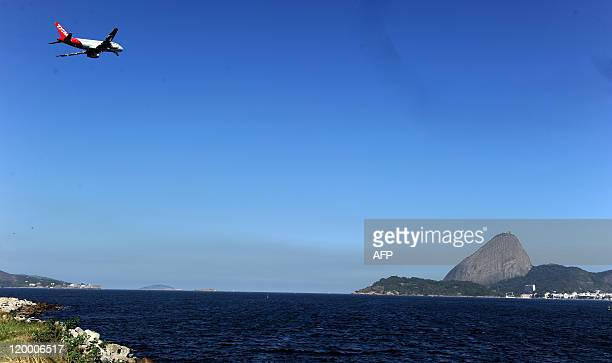 An airliner takes off from the Santos Dumont domestic airport on July 28 2011 in Rio de Janeiro Brazil The airport will be closed during the FIFA's...